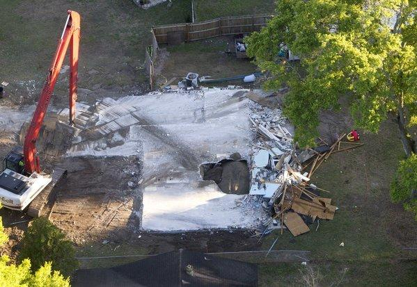 The giant sinkhole at the home of Jeff Bush in Seffner, Fla., has been filled in with dirt.