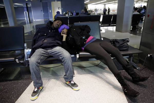 Diandre Hines and Shauntae McKnight both of Chicago sleep at O'Hare International Airport.