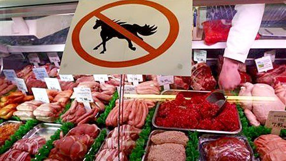"A butcher's shop displays a ""no horsemeat"" sign in Market Harborough, central England in February."
