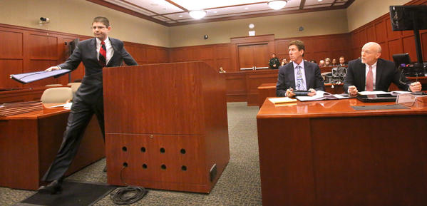 FDLE attorney David Margolis (left) hands document to the judge as George Zimmerman's lead defense attorneys, Mark O'Mara and Don West, watch during a status hearing in the Trayvon Martin case, in Seminole circuit court, in Sanford, Fla., Tuesday, March 5, 2013.