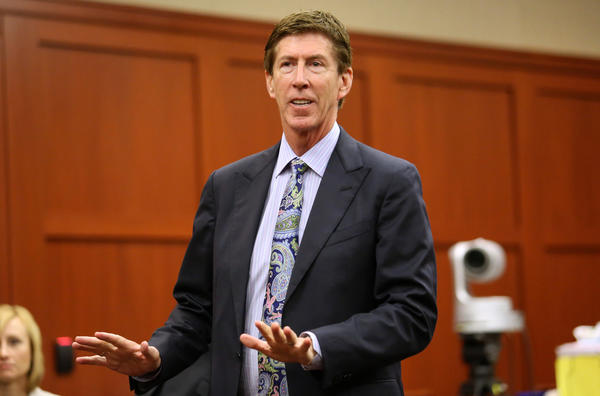George Zimmerman's lead defense attorney, Mark O'Mara, talks during a recess at a status hearing in the Trayvon Martin case, in Seminole circuit court, in Sanford, Fla., Tuesday, March 5, 2013. (Joe Burbank/Orlando Sentinel)  Newsgate CCI id:   .B582759321Z.1