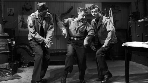 "<b>SERVICE COMEDY:</b> Jack Lemmon, right, cavorts with Mickey Rooney, center, in the 1957 comedy ""Operation Mad Ball,"" one of five films in the new Sony set."
