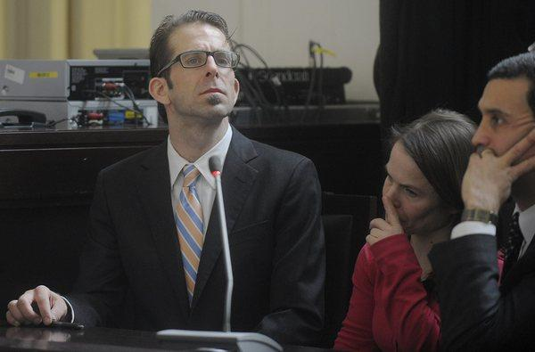 Randy Blythe, frontman of the heavy metal band Lamb of God, listens to the final judgment in court in Prague, Czech Republic.