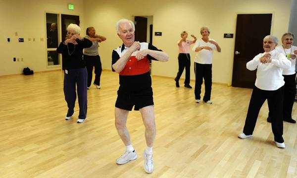 Seniors dance in the Zumba class at Charlestown Retirement Community. Jack Jackson is in front.