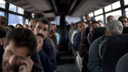 JERUSALEM -- Israel is under fire from civil rights groups after launching a new West Bank transportation service for Palestinians that is expected to keep them off the buses used by Jewish settlers.