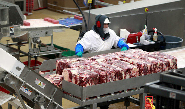 Agriculture Secretary Tom Vilsack said furloughs of meat inspectors won't happen for at least several more months. Meatpackers cannot operate without a USDA inspector present.