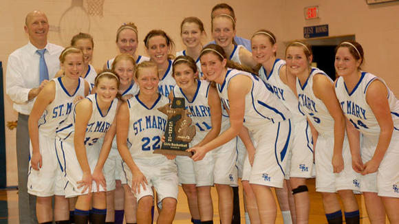 The St. Mary girls' squad poses with their newest District title trophy.