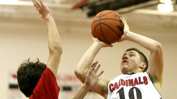 J-L junior Coalton Huff goes up for a shot during the Cardinals¿ 44-37 loss to Tawas Area in Monday's Class C District at Johannesburg.