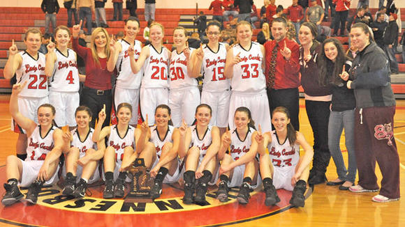 The J-L girls' basketball team celebrates its victory in the Class C District.