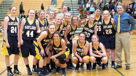 The Gaylord girls' basketball squad celebrates with their first district trophy since 1995.