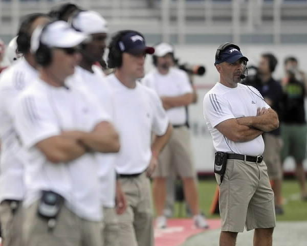 Florida Atlantic University head coach Carl Pelini, right, watches the action on the field during the team,Äôs spring game in Boca Raton. JOSH RITCHIE