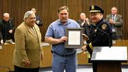 A routine trip to the gas station turned into a Citizen Award of Valor Monday night for a Des Plaines man honored by city officials for his quick thinking in extinguishing a fire at a gas station in January.