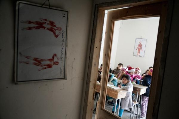 Children attend the one class still open in Mashhad School in Aleppo, Syria.