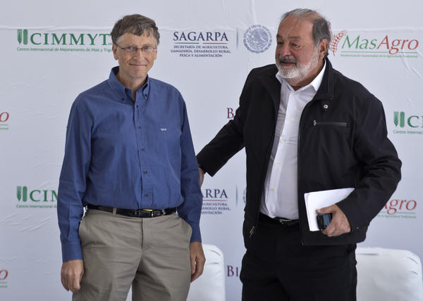 The world's two richest people, Mexican tycoon Carlos Slim, right, and Microsoft founder Bill Gates, speak at the inauguration of the International Maize and Wheat Improvement Center, built with funds from their foundations, in Texcoco, Mexico.