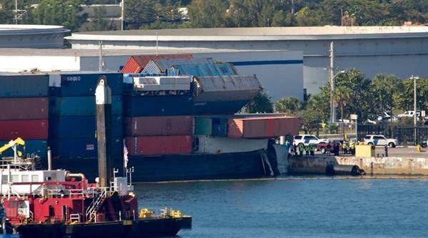 A cargo vessel loaded with some toppled containers was helped into Port Everglades Monday night