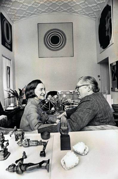 The Netsch art collection forms the background for this photo of Dawn and Walter in the living room of their Near North Side apartment.