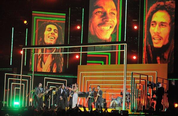 Rihanna, Bruno Mars, Sting, and Ziggy and Damian Marley perform in tribute to Bob Marley during the 55th Grammy Awards. The musician's sustained popularity attracted new deals with CAA, Bravado.