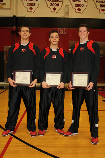 John Solari, Frank Dounis and Danny Quinn led the Maine South basketball team to its first conference win since 1999.