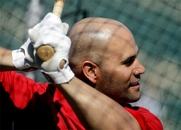 Angels first baseman Albert Pujols takes batting practice during spring training.