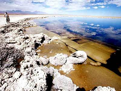The aquamarine waters of Sejas Lagoon are a pleasure for bathers and sightseeing bikers, but the challenge is getting to the shoreline: The lake is surrounded with clusters of razor-sharp salt crystals.