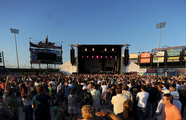John Mellencamp plays during the Bob Dylan Show at Coca-Cola Park on Tuesday.