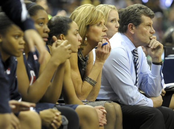 UConn women's basketball coach Geno Auriemma and his players and coaching staff watch as Notre Dame closes the Huskies out Monday night in South Bend.