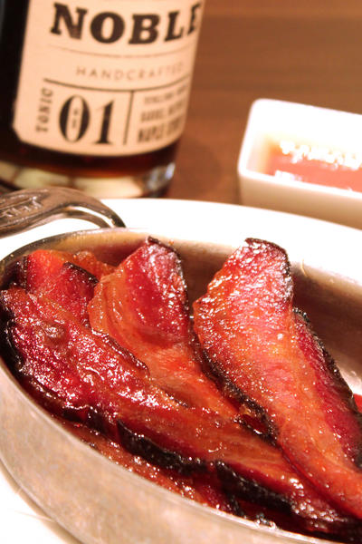 Bourbon maple syrup-glazed bacon at Emeril Lagasse's Table 10
