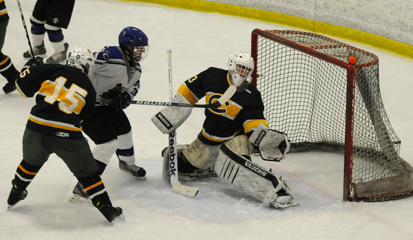 East Catholic's Vinny Genovesi, 3, scores East Catholic's second goal in the first period as Trinity Catholic's Drew Scanlan, 15, tries to defend and Trinity Catholic's Kyle Odiemo, 33, misses the save.