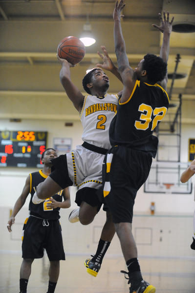 Randallstown's Ahmaad Wilson, left, shoots against Lake Clifton's Devin Jackson in the first quarter.