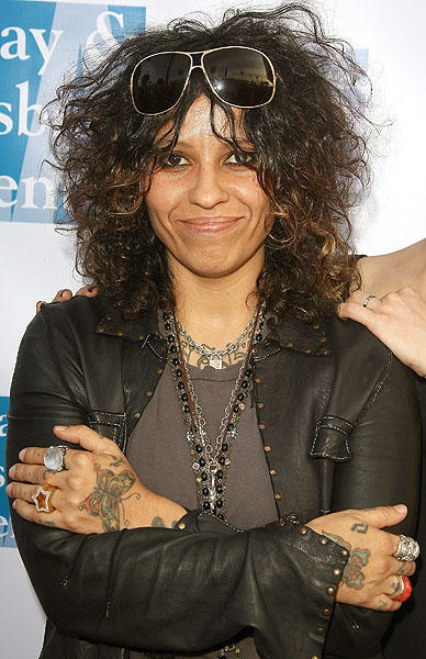 "How funny would it be if rocker Linda Perry dyed her wild hair blonde? Once the fontwoman of the seminal band 4 Non Blondes, Perry, who turns 45 today, is a songwriter and producer for musicians such as <a class=""taxInlineTagLink"" id=""PECLB005317"" title=""Gwen Stefani"" href=""/topic/entertainment/music/gwen-stefani-PECLB005317.topic"">Gwen Stefani</a> and Pink. (Photo by Valerie Macon/Getty Images)"