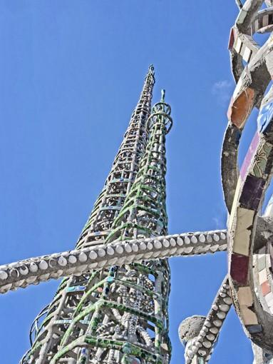 Simon Rodia's Watts Towers stretch toward the sky, the tallest reaching almost 100 feet.