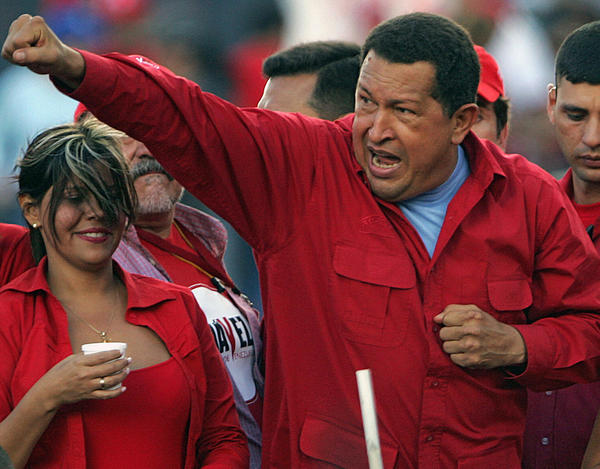 "Venezuelan President and reelection candidate Hugo Chavez gesturing to supporters during a campaign rally at ""Petare"" shantytown in Caracas on November 1, 2006."