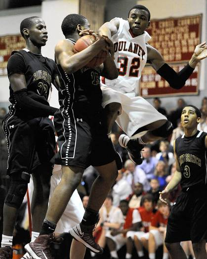 Dulaney's Stewart German battles for a rebound with Paint Branch's John Onukaogu, left, Justin Hackley, second from left, and Tre Galloway