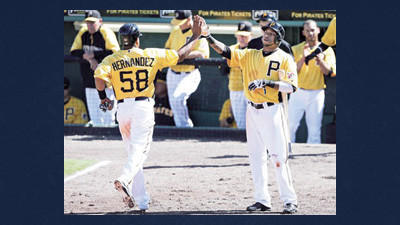 Pittsburgh Pirates' Anderson Hernandez, left, is greeted by teammate Darren Ford after scoring a run during the fourth inning of an exhibition spring training baseball game against Spain on Tuesday in Bradenton, Fla.