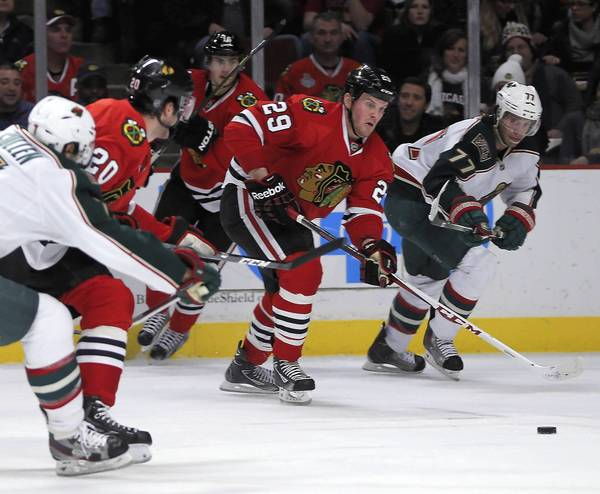 Bryan Bickell takes a pass from Brandon Saad and scores in the first period.
