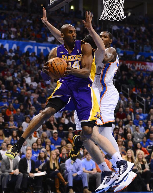 Lakers guard Kobe Bryant drives to the basket against the Oklahoma City Thunder.