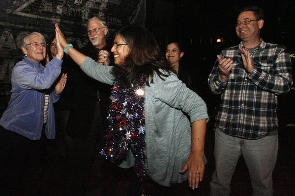 Audrey Hanson, far left, receives a high five from former mayor and Measure S campaign manager Marsha Ramos during election night, which took place Gordon Biersch in Burbank on Tuesday, March 5, 2013. With 55 percent voter approval, measure S will pass. Measure S is $110 million bond that would improve school facilities.