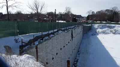 The retaining wall lining the dormant Petoskey Pointe construction site is seen Tuesday, looking west from the corner of Mitchell and Petoskey streets.