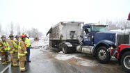 STANFORD — It was a cold and slow morning for traffic on westbound U.S. 150 between Stanford and Danville Wednesday, after a semi-truck carrying a full load of coal overturned on the slick roads.