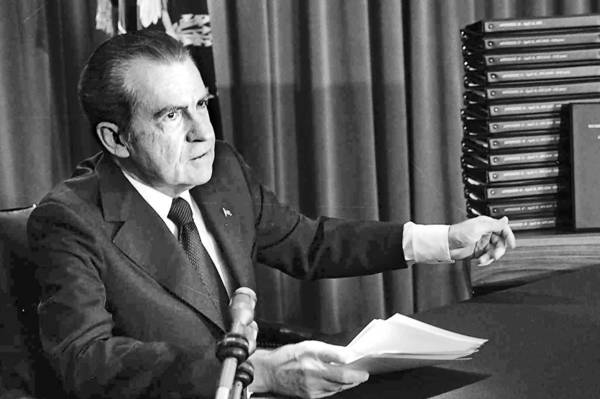 President Nixon with transcripts of the White House tapes in an April 29, 1974 address.