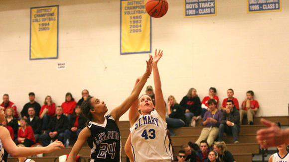 Mary Spyhalski puts in two of her 12 first half points against Leland during Tuesday's 60-28 victory over the Comets.