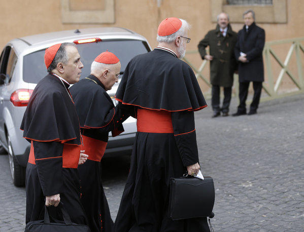 U.S. Cardinals Daniel DiNardo, left, and Sean Patrick O'Malley, right, arrive for a meeting at the Vatican on Wednesday.