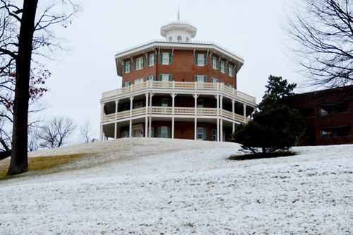 A building atop a hill on the Johns Hopkins Mt. Washington campus is surrounded by snow.