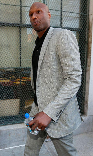 Lamar Odom arrives to attend a child-custody hearing at a court in New York on Tuesday.