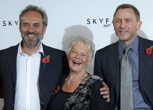 "Director Sam Mendes, left, and actors Dame Judi Dench and Daniel Craig at a press event for ""Skyfall"" in 2011. Mendes says he won't direct the next James Bond film."