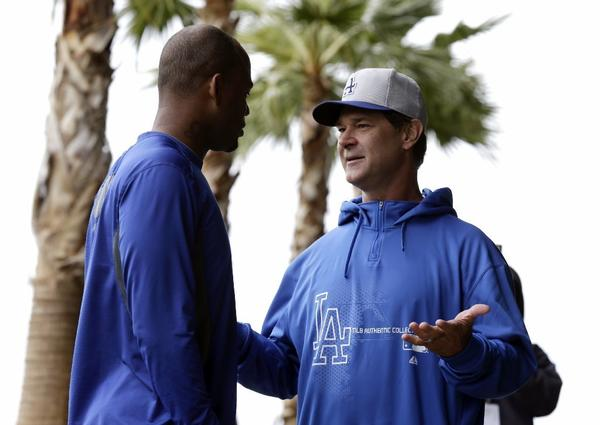 Carl Crawford talks with Dodgers Manager Don Mattingly last month.