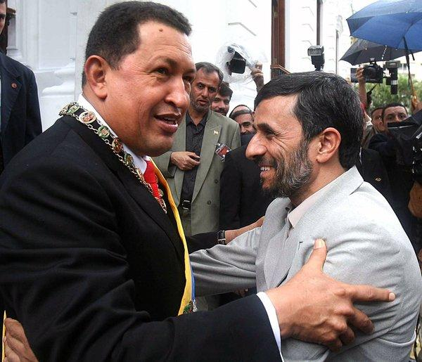 Venezuelan President Hugo Chavez, left, embraces Iranian President Mahmoud Ahmadinejad at the Miraflores Presidential Palace in Caracas.