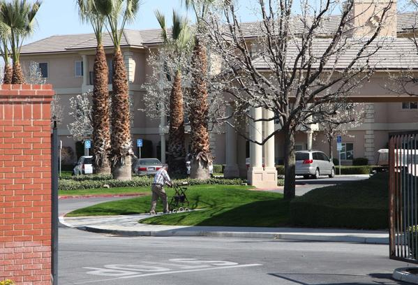 A man walks near the main gate of Glenwood Gardens in Bakersfield.
