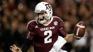 Texas A&M quarterback Johnny Manziel and his family are looking into getting insurance to protect the Heisman Trophy winner against injuries or illness he could suffer while still in school.