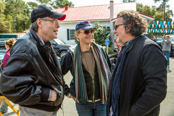 "Stephen King, left, on the set of ""Under the Dome"" with director Niels Arden Oplev and executive producer Jack Bender."